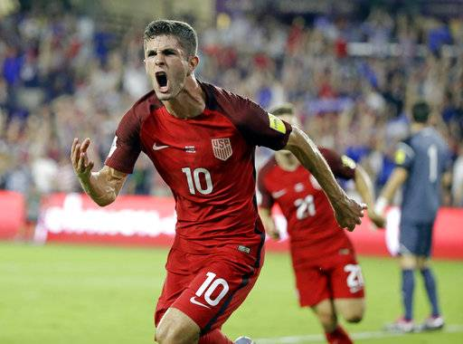 United States' Christian Pulisic (10) celebrates after scoring a goal against Panama during the first half of a World Cup qualifying soccer match, Friday, Oct. 6, 2017, in Orlando, Fla.
