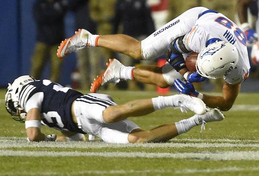Boise State's Jake Roh (88) is brought down by BYU's Zayne Anderson after a reception during an NCAA college football game Friday, Oct. 6, 2017, in Provo, Utah. (Drew Nash/The Times-News via AP)