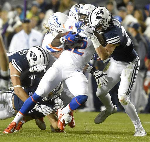 Boise State's Alexander Mattison (22) is brought down by the BYU defense during an NCAA college football game Friday, Oct. 6, 2017, in Provo, Utah. (Drew Nash/The Times-News via AP)