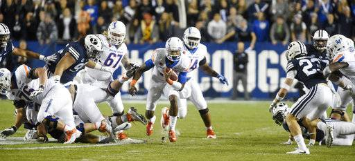 Boise State's Montell Cozart runs for a first down during the first quarter against BYU during an NCAA college football game Friday, Oct. 6, 2017, in Provo, Utah. (Drew Nash/The Times-News via AP)