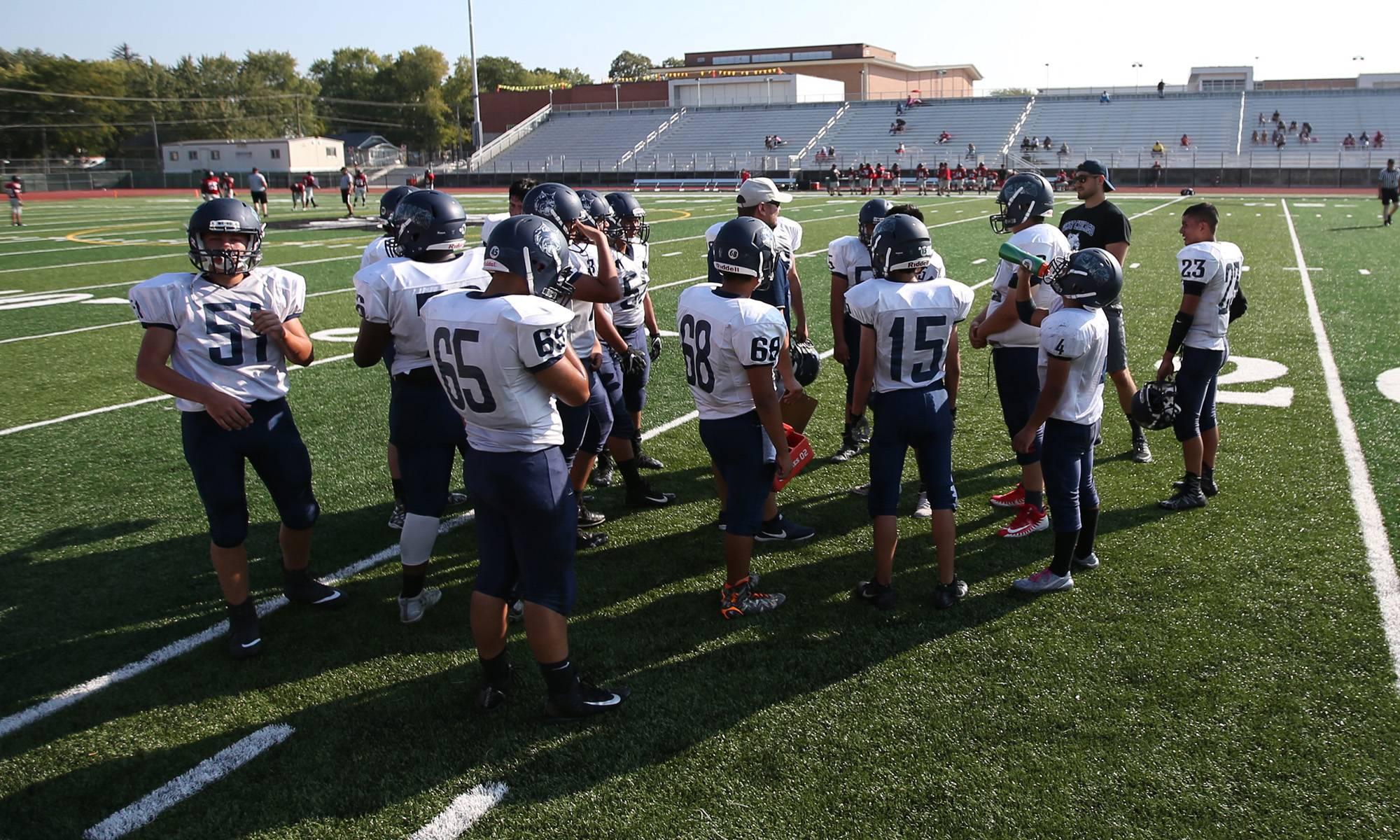 West Chicago's freshman football team gathers on the field for a game against East Aurora last month.