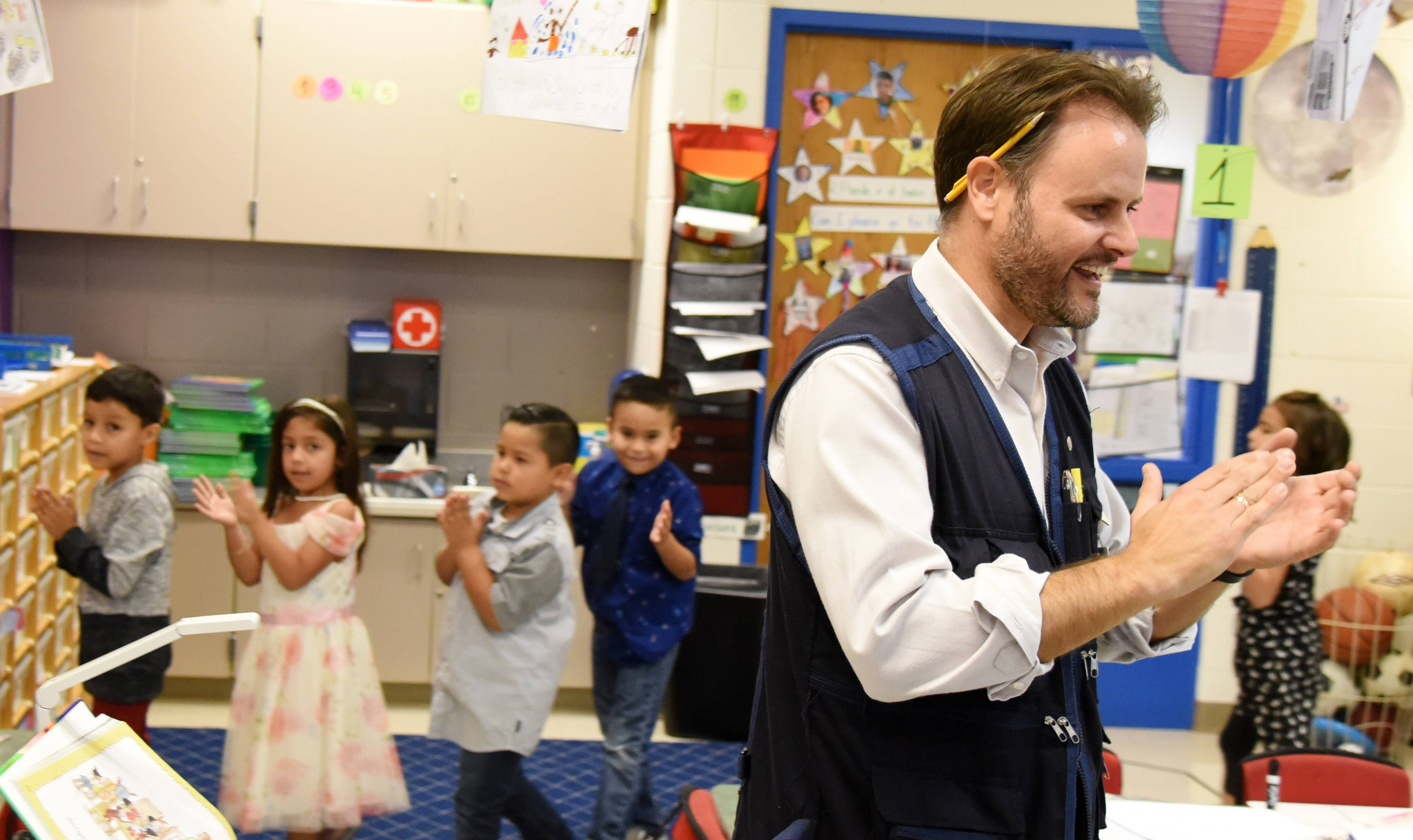 Juan Perez leads his first-grade dual language class in song at Otter Creek Elementary School in Elgin. Perez is the only male first-grade teacher at the school and a pioneer of Elgin Area School District U-46's Dual Language Program.