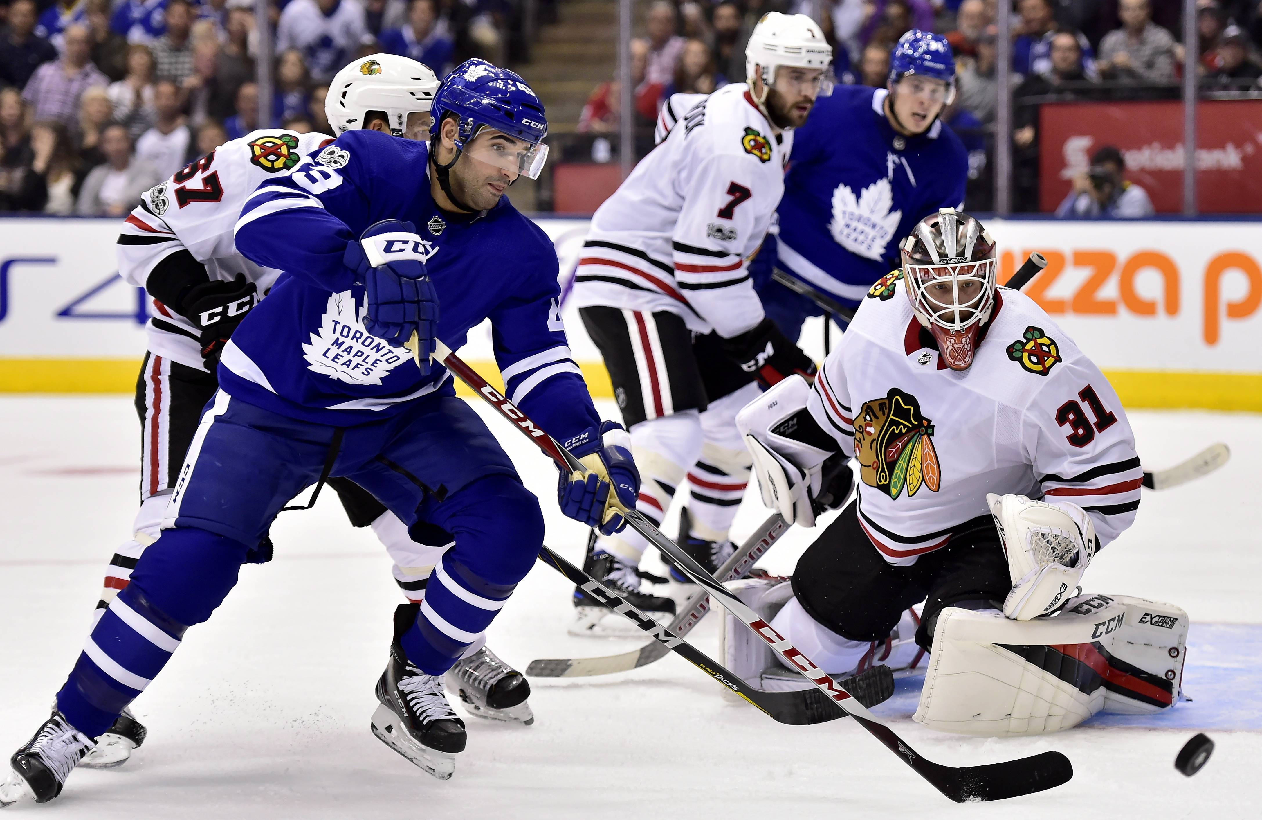 Chicago Blackhawks goalie Anton Forsberg (31) looks on as Toronto Maple Leafs center Nazem Kadri (43) chases the puck during the second period of an NHL hockey game in Toronto on Monday, Oct. 9, 2017.