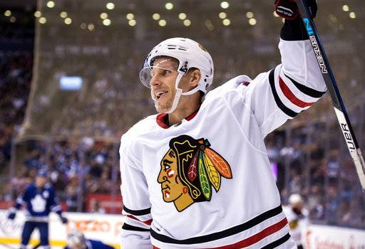 Chicago Blackhawks right wing Richard Panik (14) celebrates his goal against the Toronto Maple Leafs during the third period of an NHL hockey game in Toronto on Monday, Oct. 9, 2017. (Frank Gunn/The Canadian Press via AP)