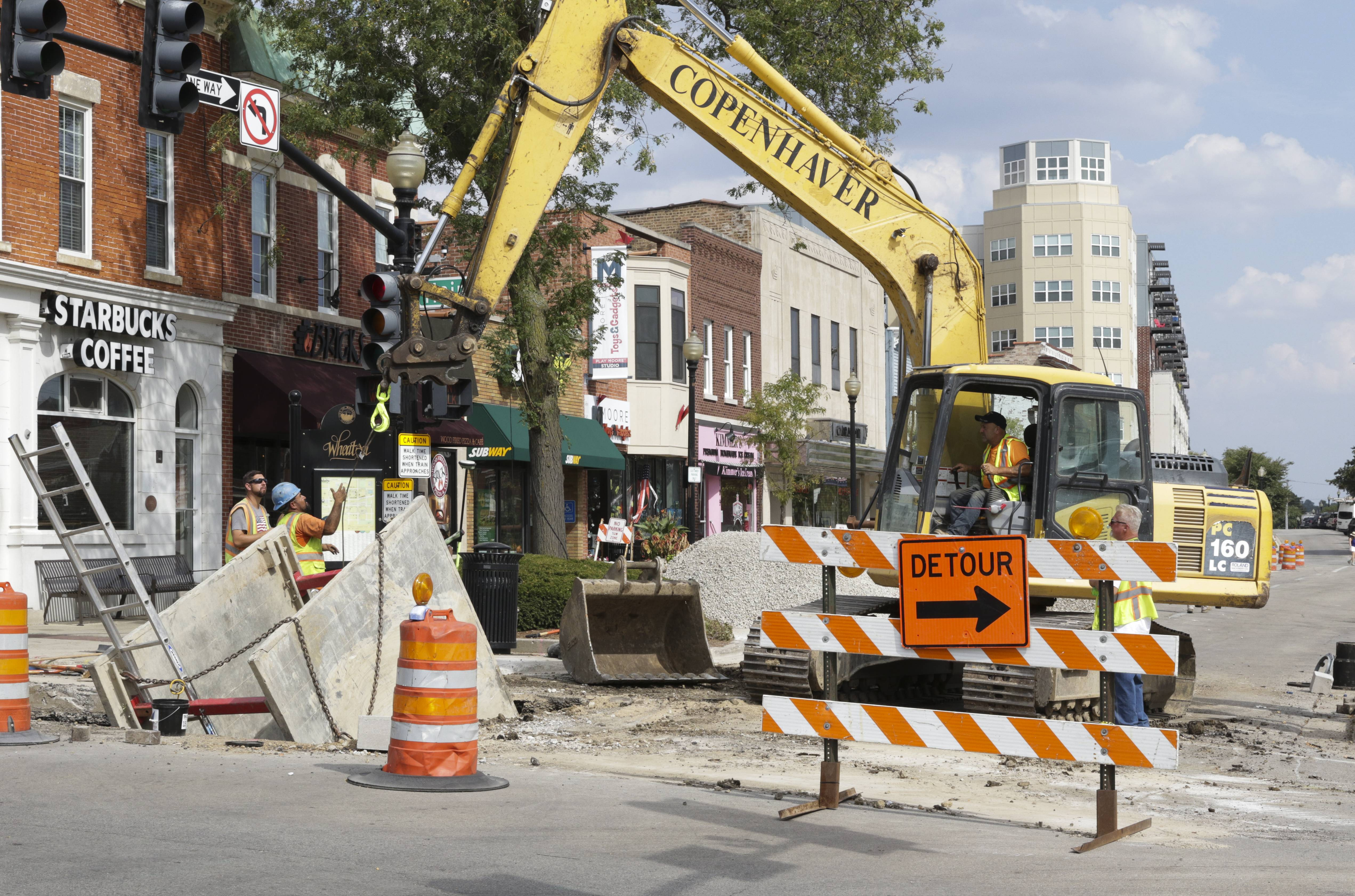 Crews are working on an infrastructure project near Front and Main streets in downtown Wheaton as part of the first phase of improvements to the core business district.