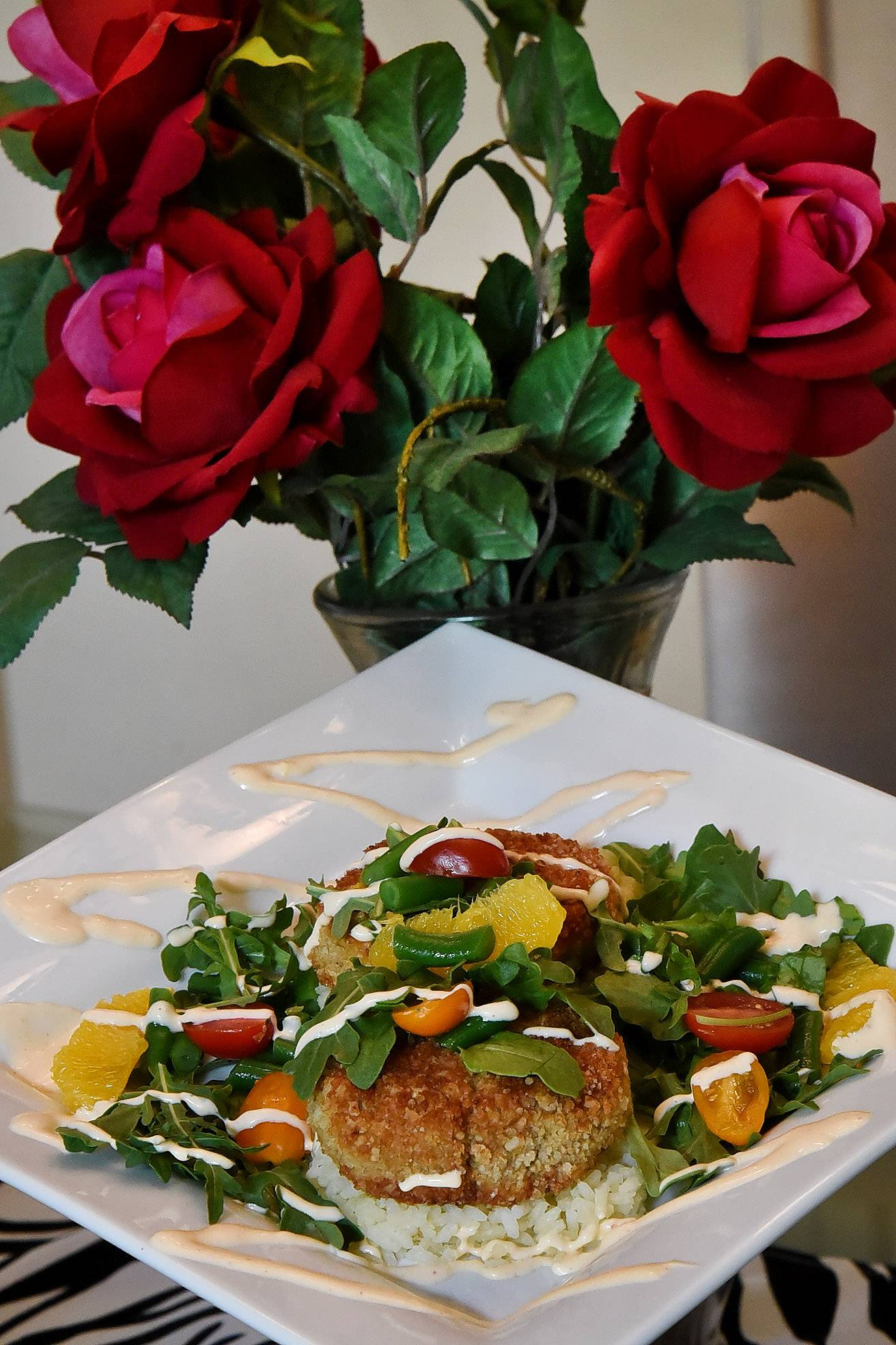Cook of the Week Challenge contestant Elizabeth Schuttler of Inverness made Mackerel Fish Cakes with Orange Rice and Green Bean, Orange and Arugula Salad Topped with a Citrus Aioli.
