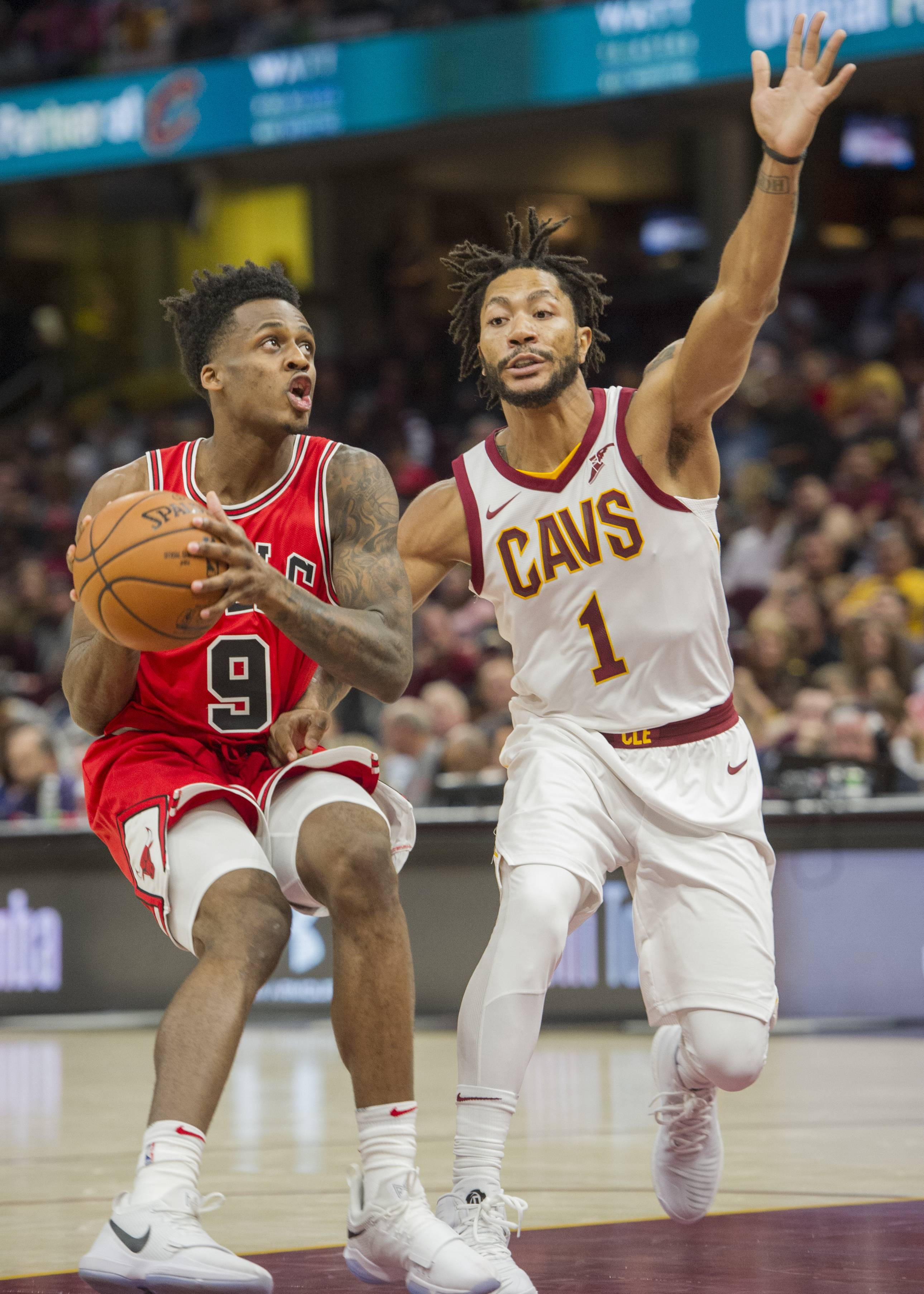 Chicago Bulls' Antonio Blakeney (9) prepares to shoot past Cleveland Cavaliers' Derrick Rose (1) during the first half of an NBA preseason basketball game in Cleveland, Tuesday, Oct. 10, 2017.