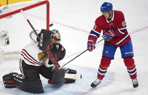 Chicago Blackhawks goalie Corey Crawford makes a save against Montreal Canadiens' Ales Hemsky (83) during the third period of an NHL hockey game in Montreal, Tuesday, Oct. 10, 2017. (Graham Hughes/The Canadian Press via AP)