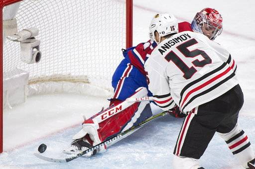 Montreal Canadiens goalie Carey Price (31) is scored on by Chicago Blackhawks' Artem Anisimov (15) during the second period of an NHL hockey game in Montreal, Tuesday, Oct. 10, 2017. (Graham Hughes/The Canadian Press via AP)