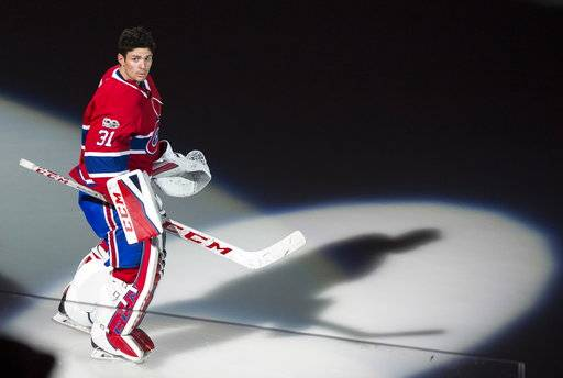 Montreal Canadiens goalie Carey Price skates onto the ice during a pre-game ceremony prior to their NHL home hockey opener against the Chicago Blackhawks in Montreal, Tuesday, Oct. 10, 2017. (Graham Hughes/The Canadian Press via AP)