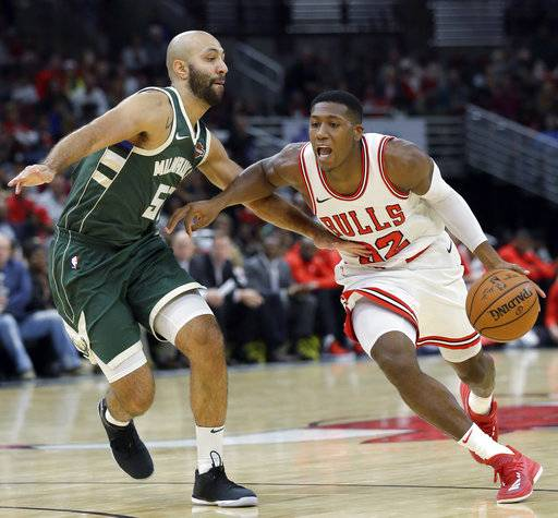 FILE - In this Friday, Oct. 6, 2017, file photo, Chicago Bulls guard Kris Dunn, right, drives as Milwaukee Bucks guard Kendall Marshall guards during the second half of a preseason NBA basketball game in Chicago. The Bulls open the season at Toronto on Oct. 19.