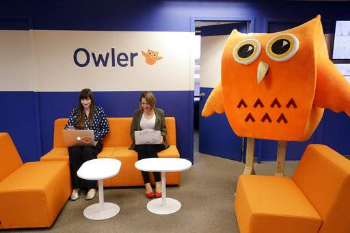 In this Tuesday, Aug. 29, 2017, photo, Owler employees Nicole Lopuch, left, and Molly Cornfield work in the company's offices in San Mateo, Calif. Many small businesses struggle because they have uncomfortable workplaces, whether it's due to space, noise or aesthetics. But many find that if they ask staffers what they want, there are ways to make their space cheerful and inspiring. (AP Photo/Marcio Jose Sanchez)