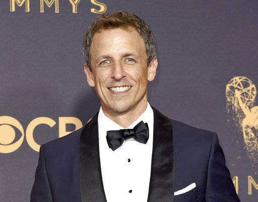 "FILE - In this Sept. 17, 2017 file photo, Seth Meyers arrives at the 69th Primetime Emmy Awards in Los Angeles. Meyers is the host of NBC's ""Late Night with Seth Meyers.� (Photo by Richard Shotwell/Invision/AP, File)"