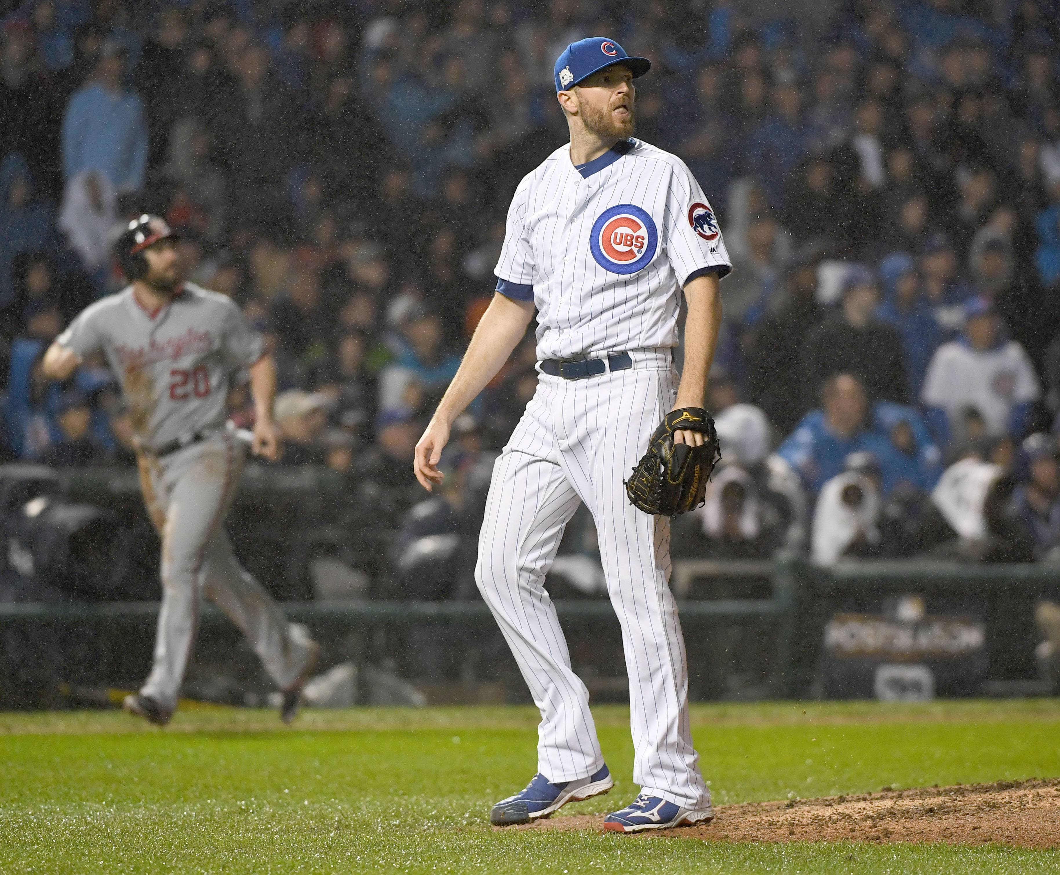 Chicago Cubs relief pitcher Wade Davis (71) watches the flight of a grand slam off the bat of Washington Nationals center fielder Michael Taylor (3) during Game 4 of the NLDS at Wrigley Field in Chicago, Ill. on Wednesday, Oct. 11, 2017.