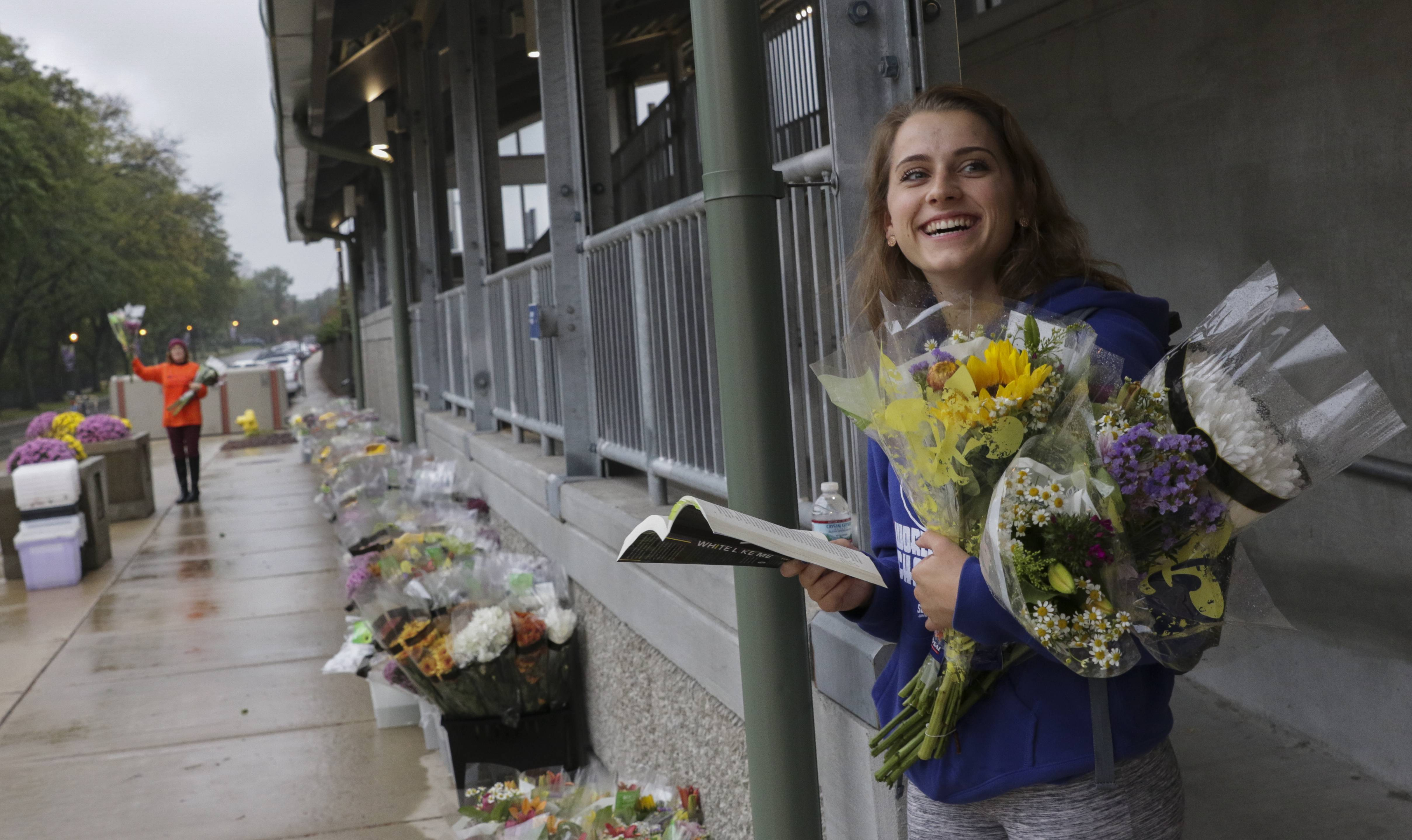 Janah Sprenger is all smiles Wednesday after getting free bouquets from FTD and Phillip's Flowers at the Lombard Metra station. The flower giveaway was part of the Petal It Forward campaign.