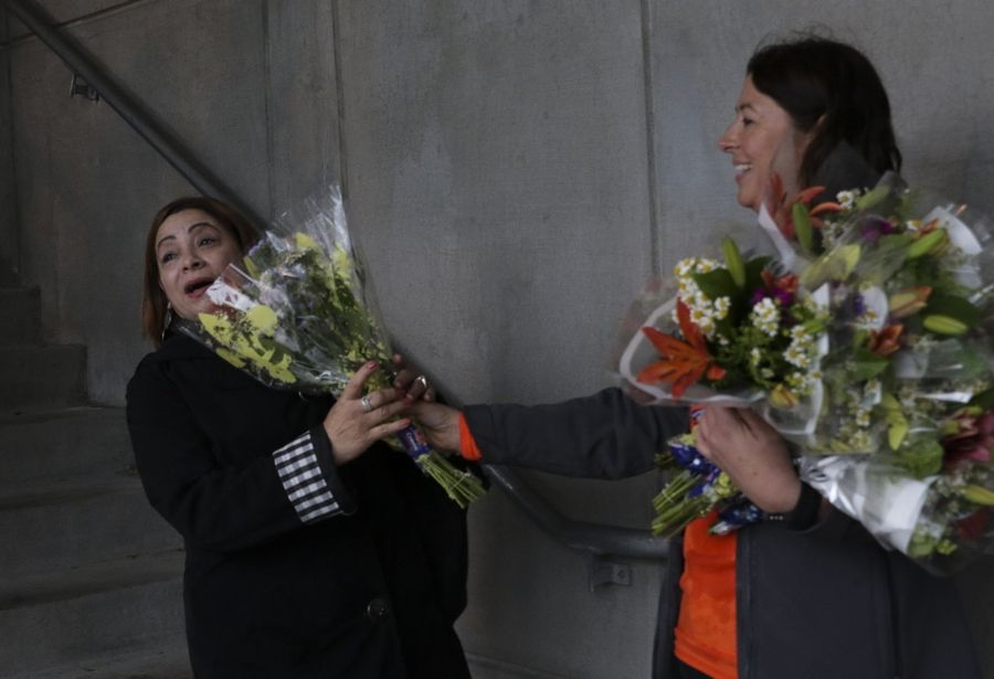 "Annette Biscan of Lombard, left, is surprised Wednesday with free flowers from Janet Justus of FTD. ""It really brightened my day,"" Biscan said."