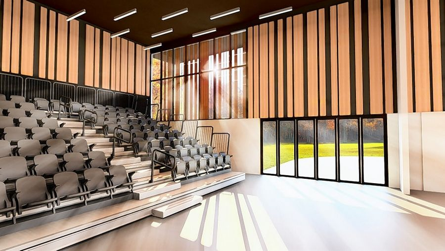 A rendering shows a multipurpose fine arts room at Aptakisic Junior High School.