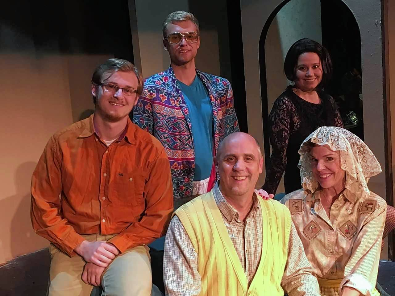 "Clockwise from left, Thomas (Sean Alyn Young), Richard (Peter Surma), Maddie (Jocelyn Adamski), Ruthie (Shannon Mayhall) and Bill (Tom Hussey) pose for a traditional holiday photo in a scene from Steel Beam Theatre's production of ""Making God Laugh,"" which opens Friday, Oct. 13, in St. Charles."