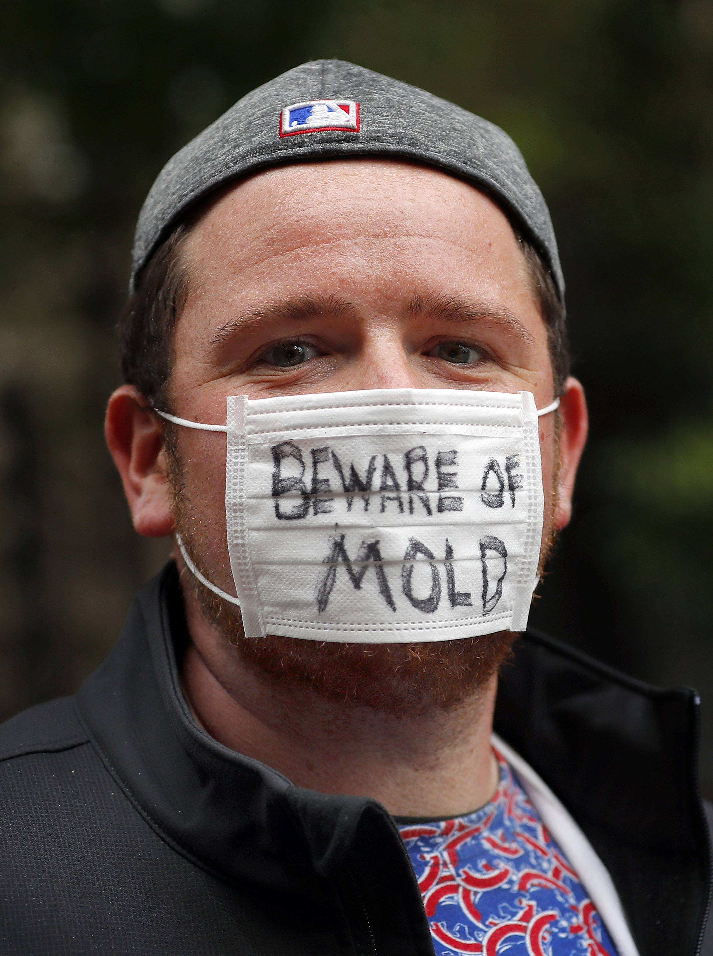 Steve Lundy/slundy@dailyherald.comRyan Denk of Rockford wears a mask that says Beware of mold prior to Game 4 of the National League division series at Wrigley Field in Chicago Wednesday, October 11, 2017.