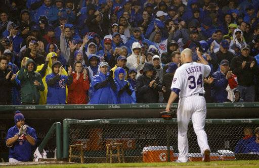 Fans cheer as Chicago Cubs' Jon Lester (34) leaves the game during the eighth inning of Game 4 of baseball's National League Division Series against the Washington Nationals, Wednesday, Oct. 11, 2017, in Chicago.