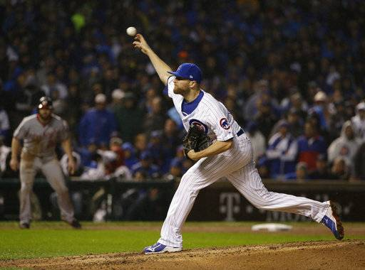 Chicago Cubs relief pitcher Wade Davis throws during the eighth inning of Game 4 of baseball's National League Division Series against the Washington Nationals, Wednesday, Oct. 11, 2017, in Chicago.