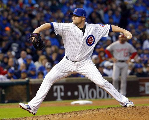 Chicago Cubs' Jon Lester throws during the fifth inning of Game 4 of baseball's National League Division Series against the Washington Nationals, Wednesday, Oct. 11, 2017, in Chicago.