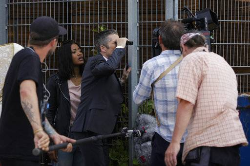 "In this photo taken on Wednesday, June 28, 2017, actors Keke Palmer, second from left, and Leland Orser, center, perform at the set for an episode of Epix's ""Berlin Station"" TV series in Berlin."