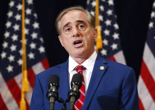 "In this Aug. 16, 2017 photo, Veterans Affairs Secretary David Shulkin speaks during a press briefing in Bridgewater, N.J. The Department of Veterans Affairs has abruptly dropped plans to suspend an ethics law barring employees from receiving benefits from for-profit colleges. The move comes after criticism from government watchdogs, who warned of financial entanglements between government and the private companies vying for millions in GI Bill tuition. In a statement to The Associated Press, the VA said it had received ""constructive comments"" and as a result would delay action. (AP Photo/Pablo Martinez Monsivais)"