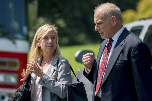 In this Aug. 22, 2017 photo, White House Chief of Staff John Kelly and Deputy Chief of Staff Kirstjen Nielsen speak together as they walk across the South Lawn of the White House in Washington. President Donald Trump is expected to nominate Kirstjen Nielsen as his next Secretary of Homeland Security. That's according to three people familiar with decision. They spoke on condition of anonymity in order to discuss deliberations before a formal announcement. Nielsen was former DHS Secretary John Kelly's deputy when he served in that role and moved with Kelly to the White House when he was tapped to be Trump's chief of staff. (AP Photo/Andrew Harnik)