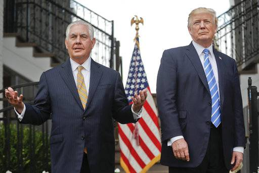 "FILE - In this Aug. 11, 2017, file photo, Secretary of State Rex Tillerson, left, speaks following a meeting with President Donald Trump at Trump National Golf Club in Bedminster, N.J. Trump challenged Tillerson to ""compare IQ tests,� delivering a sharp-edged ribbing that threw a bright spotlight on his seemingly shaky relationship with his top diplomat. The White House insisted he was only joking."