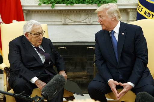 President Donald Trump speaks during a meeting with former Secretary of State Henry Kissinger in the Oval Office of the White House, Tuesday, Oct. 10, 2017, in Washington.