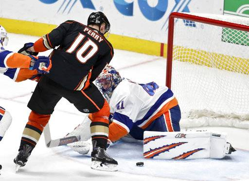 New York Islanders goalie Jaroslav Halak, right, blocks a shot by Anaheim Ducks right wing Corey Perry during the third period of an NHL hockey game in Anaheim, Calif., Wednesday, Oct. 11, 2017. (AP Photo/Chris Carlson)