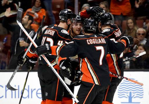 Anaheim Ducks celebrate after Rickard Rakell scored against the New York Islanders during the second period of an NHL hockey game in Anaheim, Calif., Wednesday, Oct. 11, 2017.