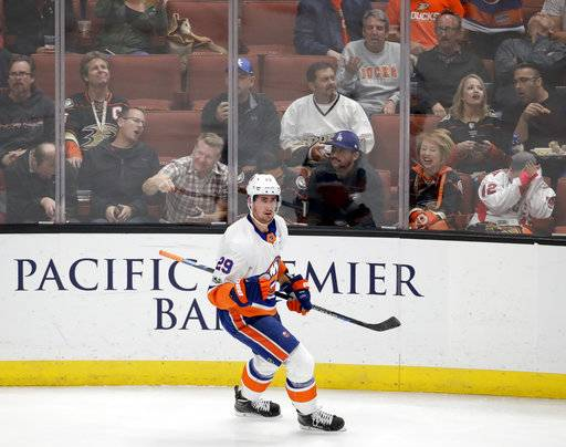 New York Islanders center Brock Nelson celebrates after scoring against the Anaheim Ducks during the third period of an NHL hockey game in Anaheim, Calif., Wednesday, Oct. 11, 2017.