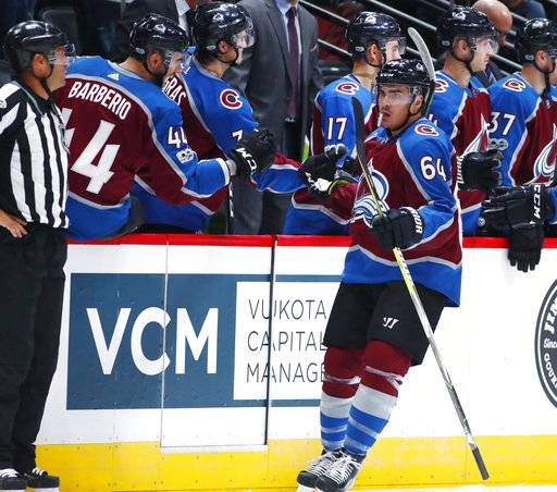 Colorado Avalanche right wing Nail Yakupov, of Russia, front, is congratulated as he passes the team box after scoring a goal against the Boston Bruins in the second period of an NHL hockey game Wednesday, Oct. 11, 2017, in Denver.