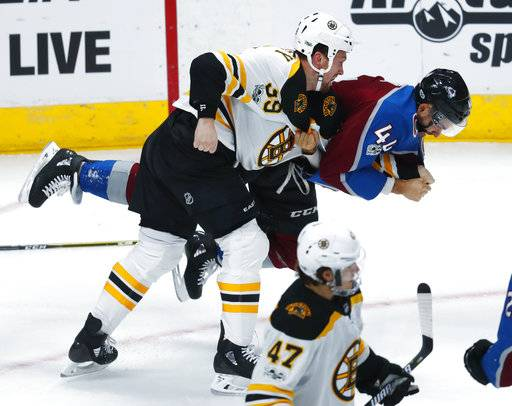 Boston Bruins left wing Matt Beleskey, front, drops Colorado Avalanche defenseman Mark Barberio to the ice as they scuffle in the first period of an NHL hockey game Wednesday, Oct. 11, 2017, in Denver.