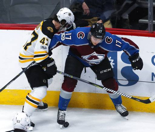 Colorado Avalanche center Tyson Jost, right, vies for control of the puck with Boston Bruins defenseman Torey Krug during the third period of an NHL hockey game Wednesday, Oct. 11, 2017, in Denver. Colorado won 6-3.
