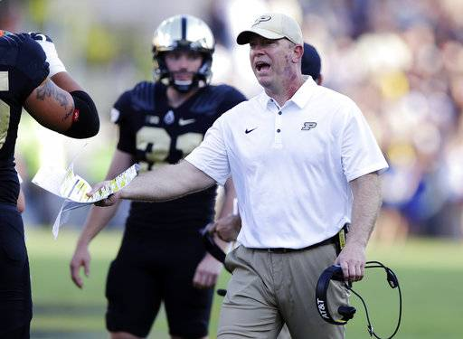 FILE - In this Sept. 23, 2017, file photo, Purdue head coach Jeff Brohm yells to an official during the first half of an NCAA college football game against Michigan in West Lafayette, Ind. rejuvenated Boilermakers rank 36th in scoring defense, 52nd in pass defense, 57th in total defense and 66th in rushing defense. (AP Photo/Michael Conroy, File)