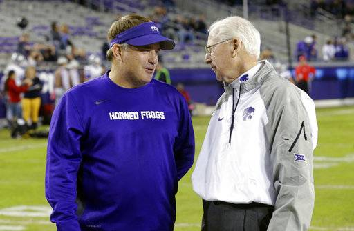 FILE - In this Nov. 8, 2014, file photo, Kansas State coach Bill Snyder, right, and TCU coach Gary Patterson talk on the field before an NCAA college football game in Fort Worth, Texas. When Horned Frogs coach Patterson faces his alma mater, it's a matchup of the two active coaches with the most wins at their current schools. (AP Photo/LM Otero, File)