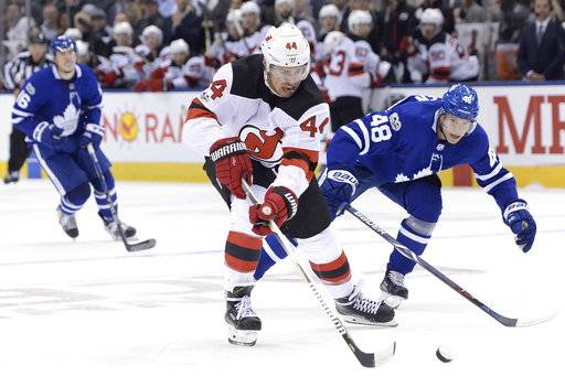 New Jersey Devils left wing Miles Wood (44) steals the puck from Toronto Maple Leafs defenseman Calle Rosen (48) to score on a breakaway during the first period of an NHL hockey game Wednesday, Oct. 11, 2017, in Toronto. (Nathan Denette/The Canadian Press via AP)