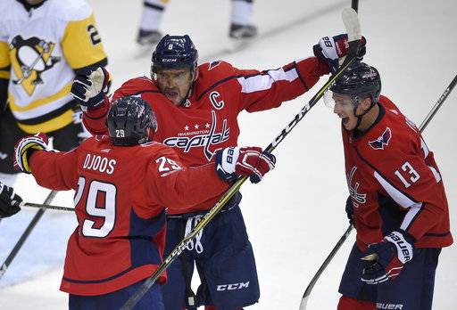 Washington Capitals left wing Alex Ovechkin (8), of Russia, celebrates his goal with defenseman Christian Djoos (29), of Sweden, and left wing Jakub Vrana (13), of the Czech Republic, during the third period of an NHL hockey game against the Pittsburgh Penguins, Wednesday, Oct. 11, 2017, in Washington. The Penguins won 3-2.