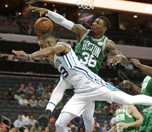 Charlotte Hornets' Terry Henderson (33) is fouled by Boston Celtics' Marcus Smart (36) in the second half of a preseason NBA basketball game in Charlotte, N.C., Wednesday, Oct. 11, 2017. (AP Photo/Chuck Burton)