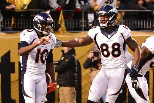 FILE - In this Dec. 20, 2015, file photo, Denver Broncos wide receiver Emmanuel Sanders (10) celebrates with wide receiver Demaryius Thomas (88) after going in for a touchdown in the first quarter of an NFL football against the Pittsburgh Steelers in Pittsburgh. The Broncos believe it's only a matter of time before star receivers Sanders and Thomas have the big games they're accustomed to.(AP Photo/Fred Vuich, File)