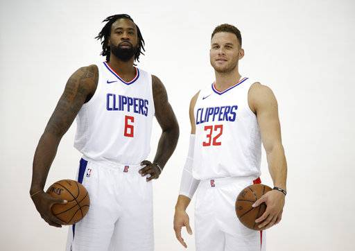 FILE - In this Sept. 25, 2017, file photo, Los Angeles Clippers' DeAndre Jordan, left, and Blake Griffin pose for photos during an NBA basketball media day, in Los Angeles. With Chris Paul newly relocated to Houston, it's up to Griffin and Jordan to lead an overhauled Clippers roster deeper into the playoffs. (AP Photo/Jae C. Hong, File)