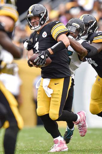 Jacksonville Jaguars defensive end Dante Fowler (56) sacks Pittsburgh Steelers quarterback Ben Roethlisberger (7) in the third quarter of an NFL football game, Sunday, Oct. 8, 2017, in Pittsburgh. (AP Photo/Don Wright)