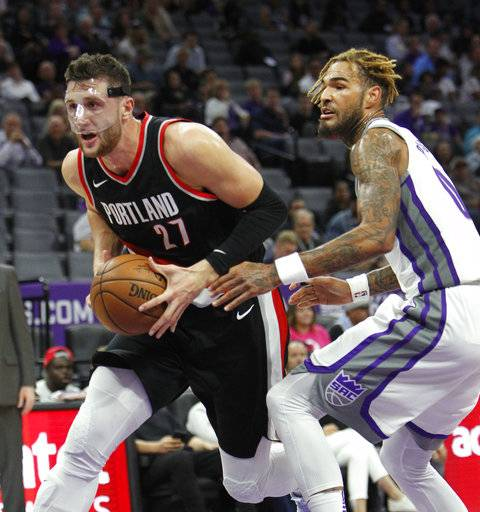 Portland Trail Blazers center Jusuf Nurkic (27) drives past Sacramento Kings defender Willie Cauley-Stein (00) during the first half of an NBA preseason basketball game in Sacramento, Calif., Monday, Oct. 9, 2017. (AP Photo/Steve Yeater)