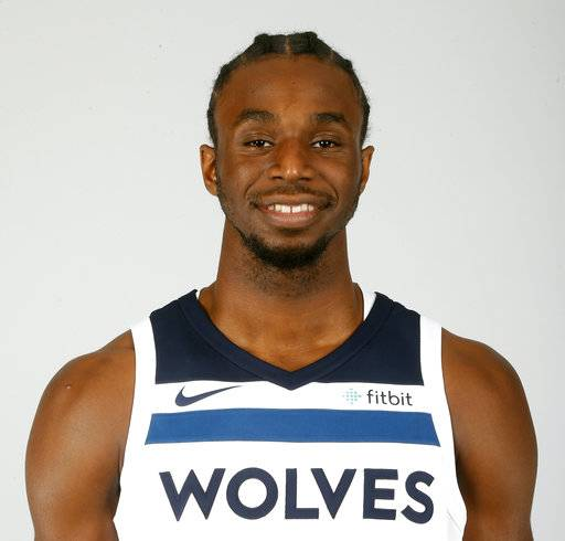 FILE - This is a Sept. 22, 2017, file photo showing Minnesota Timberwolves' Andrew Wiggins posed during the NBA basketball team's media day  in Minneapolis. The Timberwolves have signed Andrew Wiggins to a new contract extension. The Timberwolves announced on Wednesday, Oct. 11, 2017, that the two sides had reached agreement on a multiyear contract. Terms were not disclosed, but owner Glen Taylor said in August that he had offered Wiggins a five-year max contract worth $148 million.