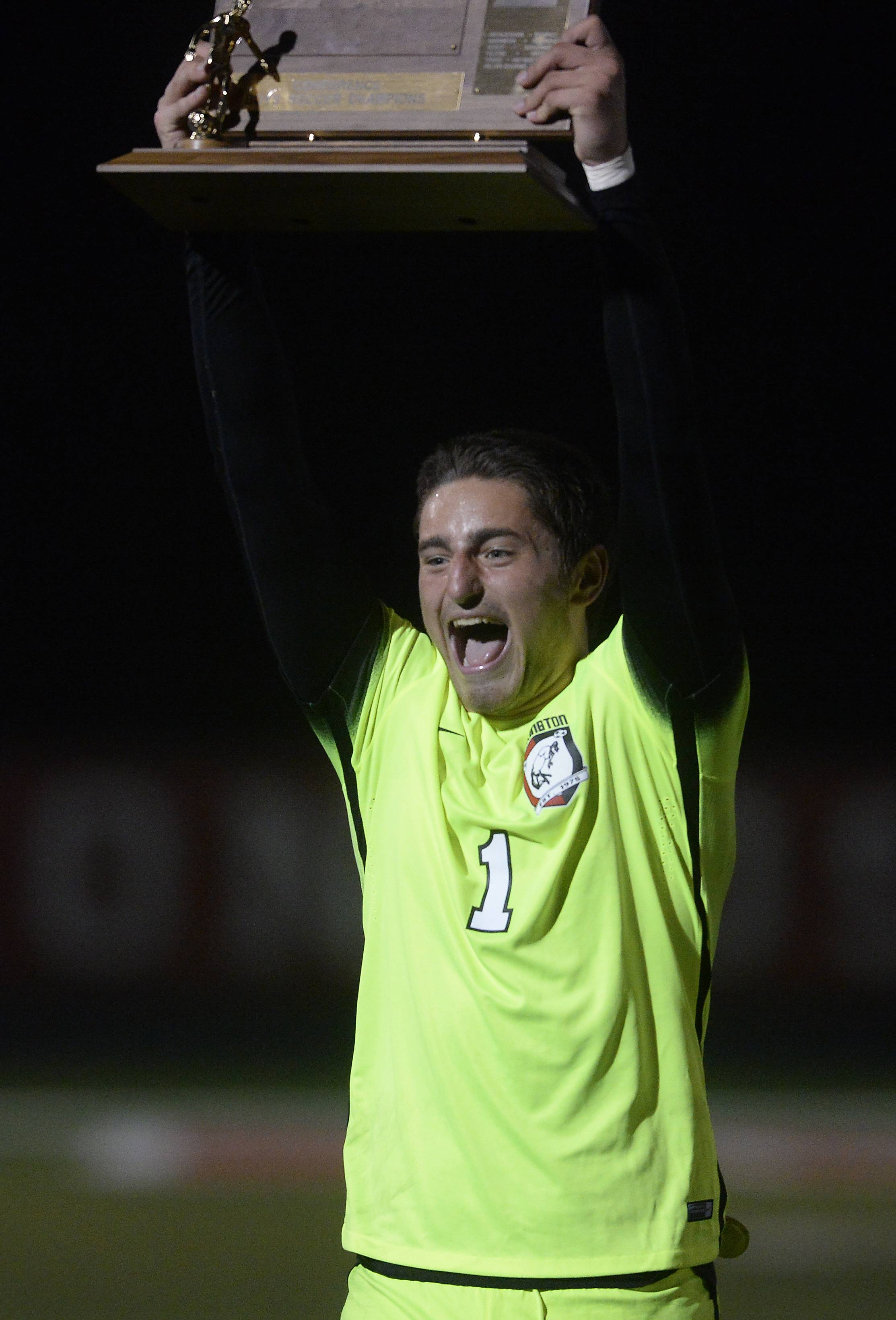 Barrington goalie Brett Sprengel holds up the MSL trophy after the Broncos' 1-0 victory over Buffalo Grove in the MSL Soccer Cup Thursday.
