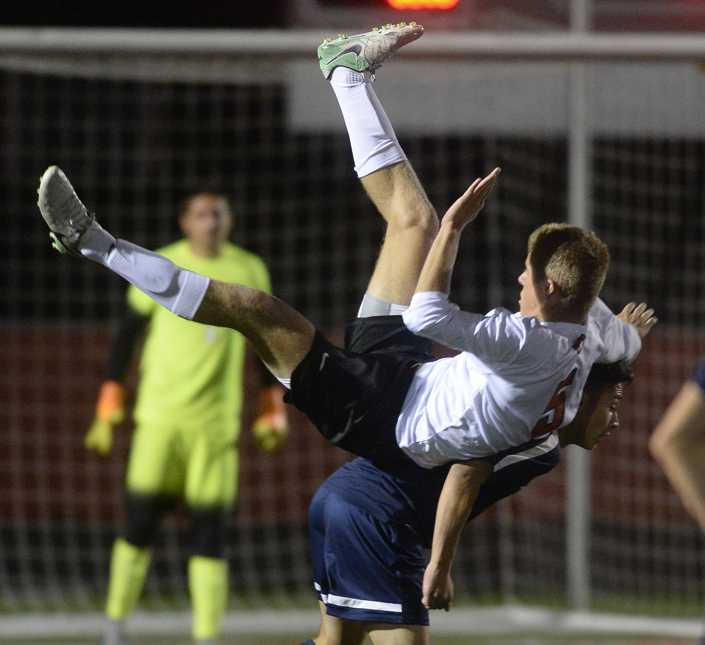 Barrington's Charlie Frank goes up and over Buffalo Grove's Alexis Escobar in the second period of the MSL Soccer Cup on Thursday in Barrington.