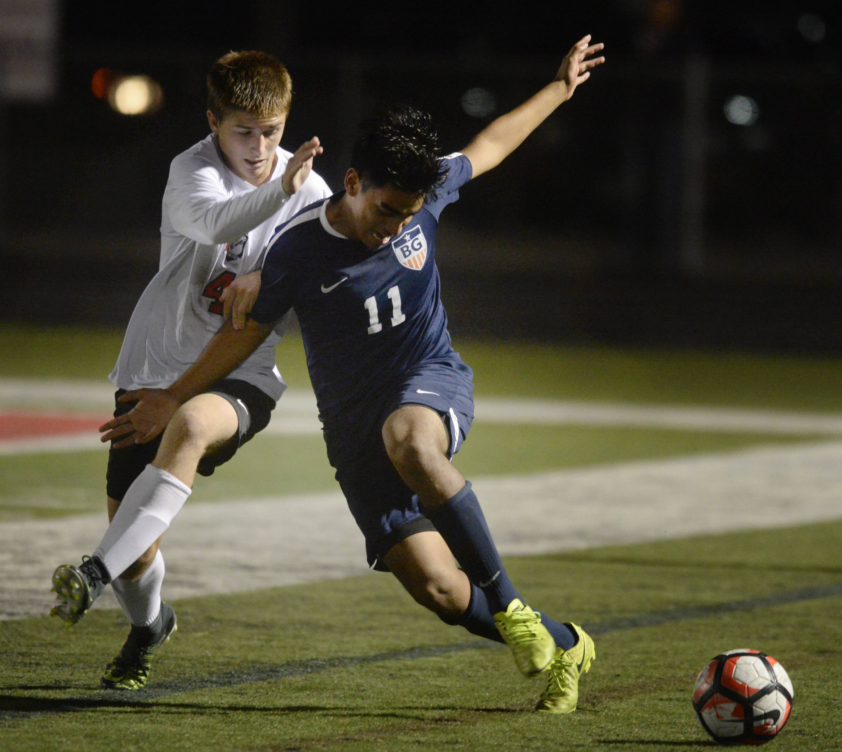 Barrington's Connor Delahunt battles Manny Mazariegos of Buffalo Grove in the MSL boys soccer championship game at Barrington.